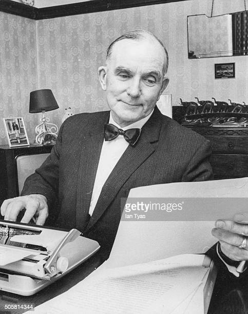 Portrait of British executioner Albert Pierrepoint writing his memoirs at a typewriter circa 1973