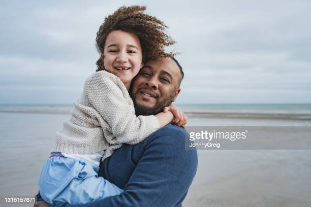 portrait of british father and daughter at camber sands - wind stock pictures, royalty-free photos & images