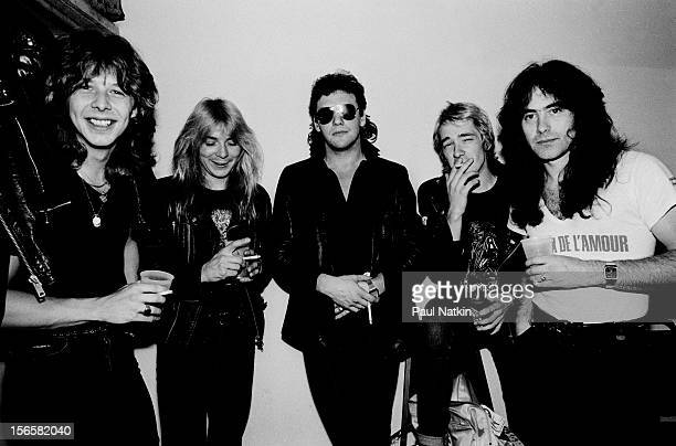 Portrait of British heavy metal band Iron Maiden backstage at Pointe East during their Killer World Tour Lynwood Illinois June 26 1981 Pictured are...
