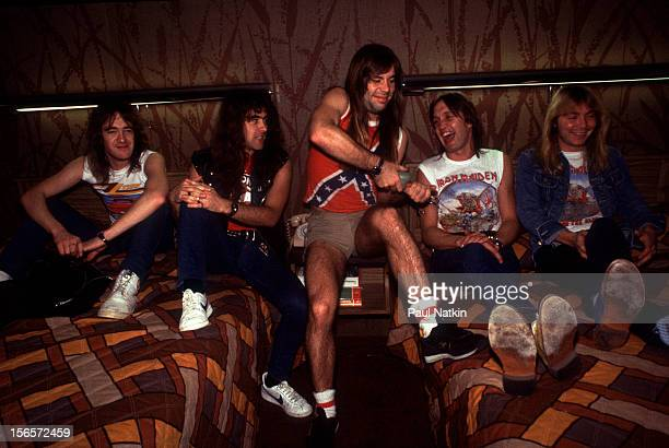 Portrait of British heavy metal band Iron Maiden in an hotel room before a show at the Holiday Star Theater during their Beast on the Road Tour,...