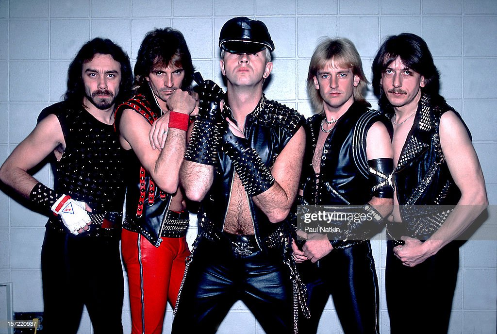 Portrait of British heavy metal group Judas Priest as they pose backstage at the Rosemont Horizon, Rosemont, Illinois, June 14, 1984. Pictured are, from left, bass player Ian Hill, guitarist Glenn Tipton, singer Rob Halford, guitarist KK Downing, and drummer Dave Holland.