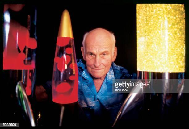 Portrait of British inventor Edward Craven Walker who poses with several of his creations including the Astro lamp or as it later came to be called...