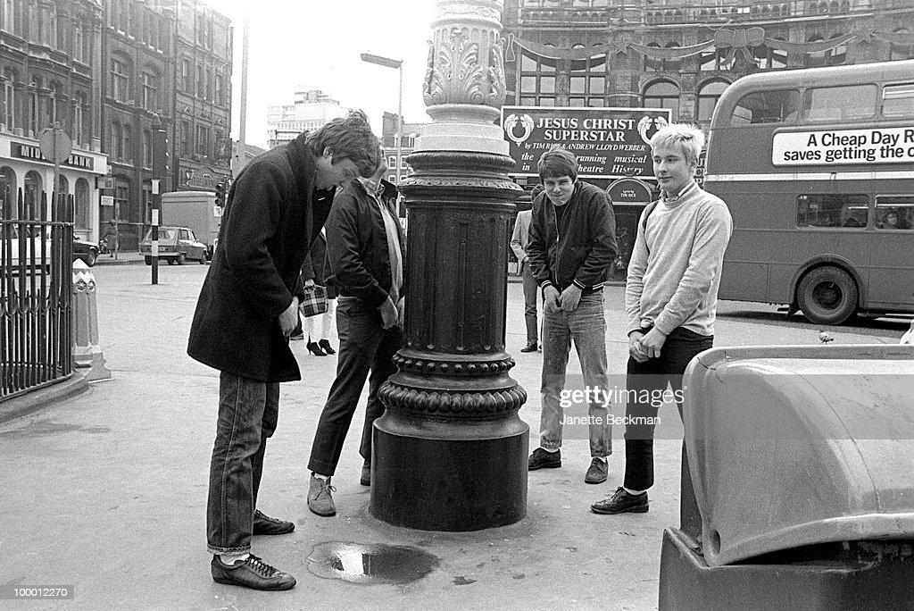 Portrait of British mod rock group Purple Hearts as they clown about in Soho, London, England, 1980. Pictured are, from left, guitarist Simon Stebbing, drummer Gary Sparks, singer Bob Manton, and bass player Jeff Shadbolt, and