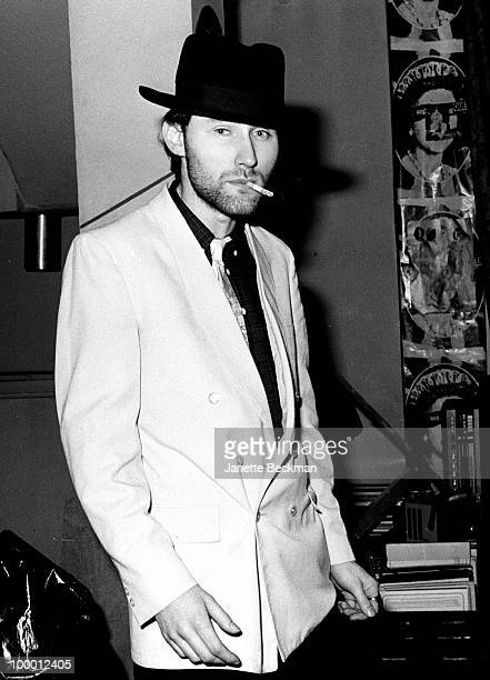 Portrait of British musician Jah Wobble of the post-punk band Public Image Ltd as smokes a cigarette in band leader John Lydon's apartment, London,...