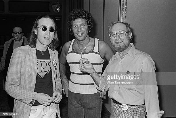 Portrait of British musicians John Lennon and Tom Jones along with an unidentified man as they pose together at the Hilton Hotel New York New York...