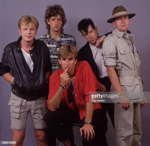 Portrait of British New Wave group the Fixx as they pose at the Poplar Creek Music Theater Hoffman Estates Illinois July 5 1986 Pictured are from...