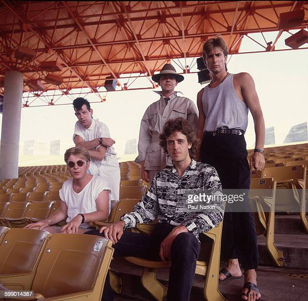 Portrait of British New Wave group the Fixx as they pose outdoors at the Poplar Creek Music Theater Hoffman Estates Illinois July 5 1986 Pictured are...