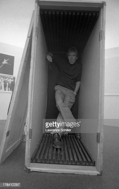 Portrait of British photographer Antony ArmstrongJones 1st Earl of Snowdon as he stands in a packing crate Des Moines Iowa 1974 The crate had been...