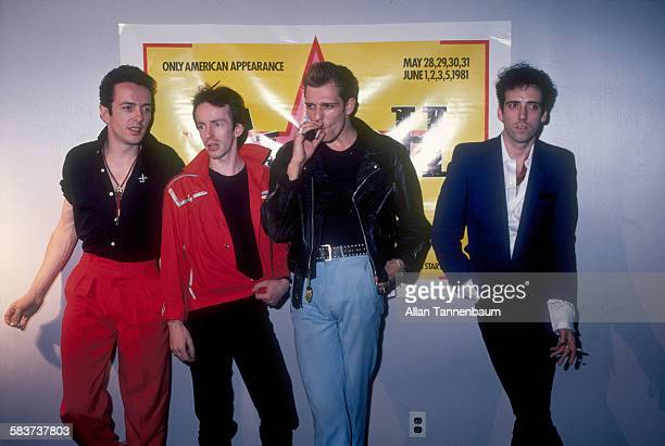 Portrait of British punk rock group the Clash, from left, Joe Strummer, Topper Headon, Paul Simenon, and Mick Jones, as they give a press conference...