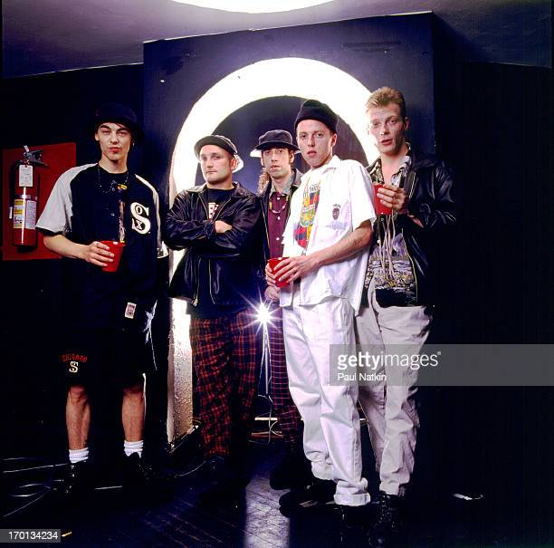 Portrait of British rock and dance group Big Audio Dynamite II as they pose backstage, Chicago, Illinois, April 10, 1992. Band leader Mick Jones is...