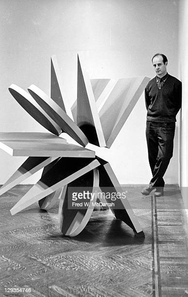 Portrait of British sculptor Phillip King as he poses with one of his works during an exhibition at the Stable Gallery New York New York April 15 1966