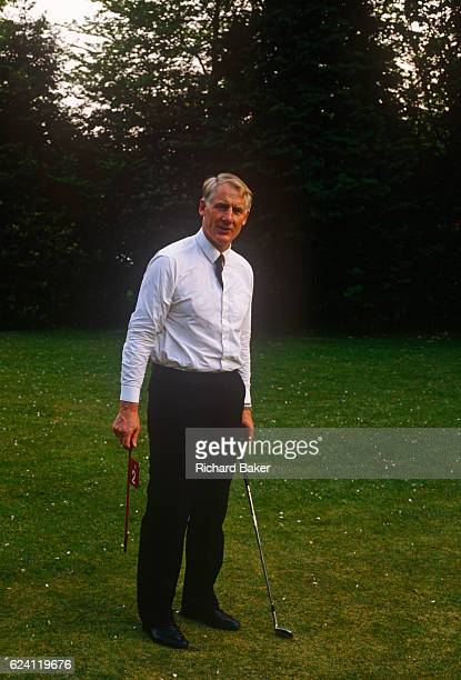 A portrait of British senior civil servant Sir Robin Butler while practicing putting in the summer of 1989 at the Civil Service College at...