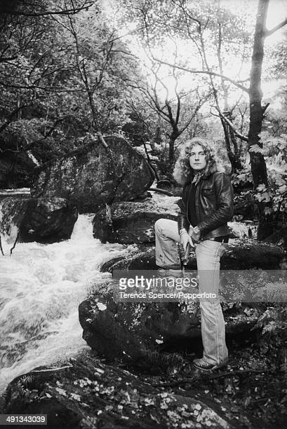 Portrait of British singer and musician Robert Plant of rock group Led Zeppelin, posed beside a stream by his home near Machynlleth in Wales on 15th...