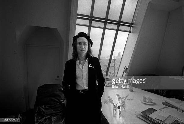 Portrait of British singer and songwriter John Lennon as he stands beside the kitchen table in his apartment in the Dakota New York New York February...