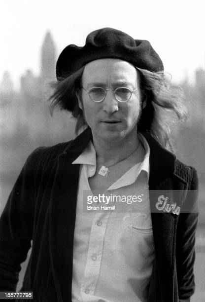 Portrait of British singer and songwriter John Lennon on the roof of his apartment building the Dakota New York New York February 25 1975 The view...