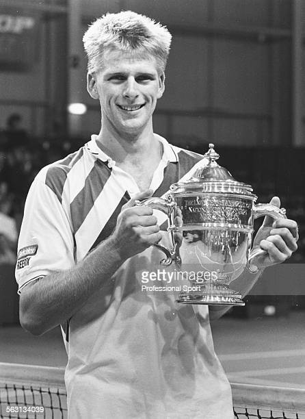 Portrait of British tennis player Andrew Castle holding his trophy at the National Tennis Championships 1987