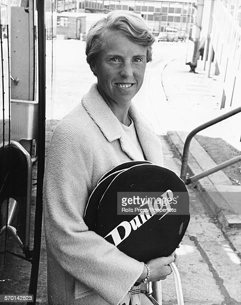 Portrait of British tennis player Ann Jones holding her Dunlop tennis rackets as she arrives back from Moscow at London Airport August 23rd 1966