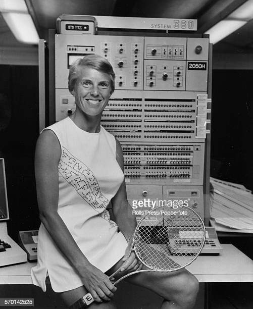 Portrait of British tennis player Ann Jones wearing a tennis dress with dot matrix motif by designer Teddy Tinling and holding a racket as she poses...