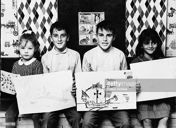 Portrait of Britishborn actor Elizabeth Taylor's children Maria Burton Christopher Wilding Michael Wilding and Elizabeth Todd October 13 1964 All the...