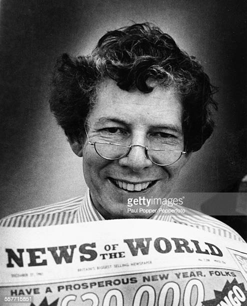 Portrait of broadcaster and journalist Derek Jameson posing with a copy of the 'News of the World' newspaper as he is appointed its new editor London...