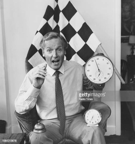 Portrait of broadcaster Nicholas Parsons with a checkered flag and a stop clock photographed for Radio Times in connection with the BBC Radio 4...