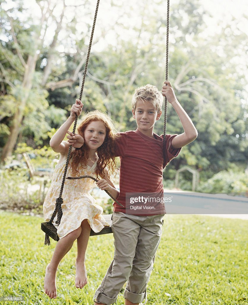 Portrait of Brother and Sister By a Swing : Stock Photo