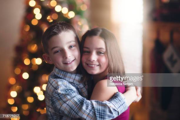 Portrait of brother and sister, hugging