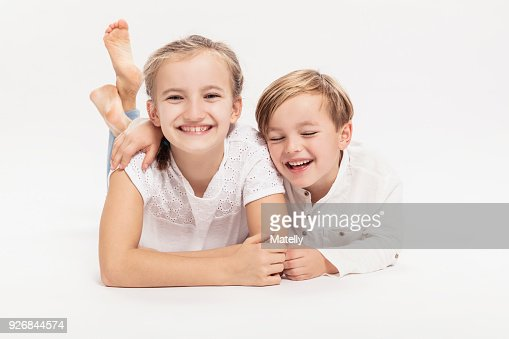 Portrait Young Brother Sister Sitting Together Stock Photo