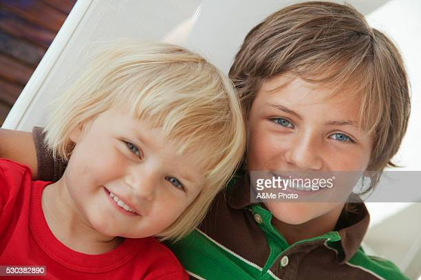 Portrait of brother and sister posing together and smiling