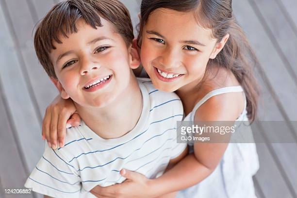 portrait of brother and sister smiling - brother stock pictures, royalty-free photos & images