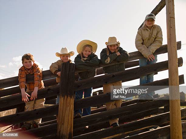 Portrait of brothers and sisters on family ranch
