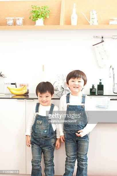 Portrait of brothers in a kitchen