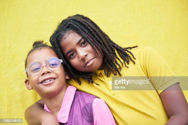portrait of brothers on yellow background - locs hairstyle stock pictures, royalty-free photos & images