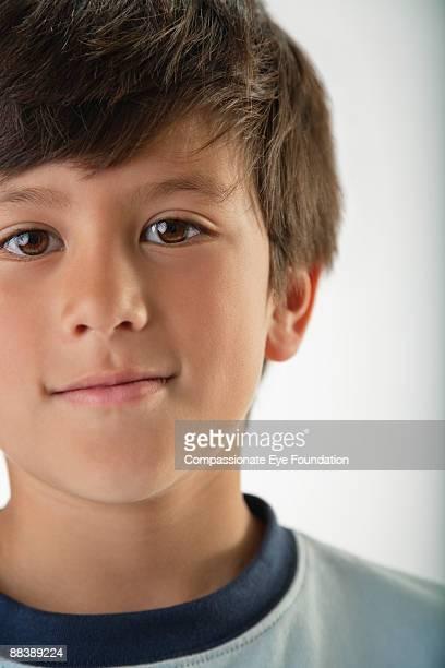 "portrait of brown eyed boy - ""compassionate eye"" foto e immagini stock"