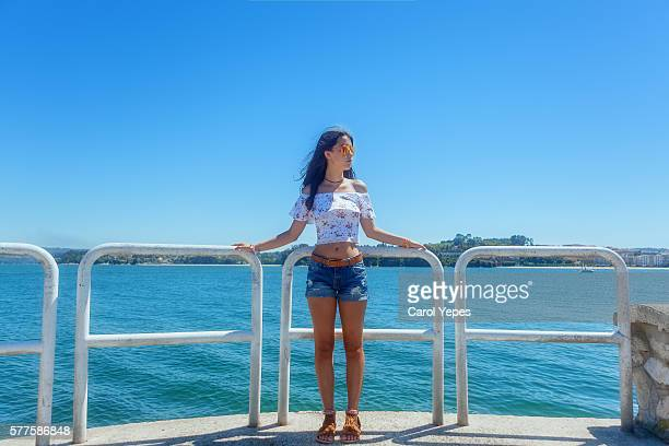 portrait of brunette girl in shorts outdoors - beautiful long legs stock pictures, royalty-free photos & images