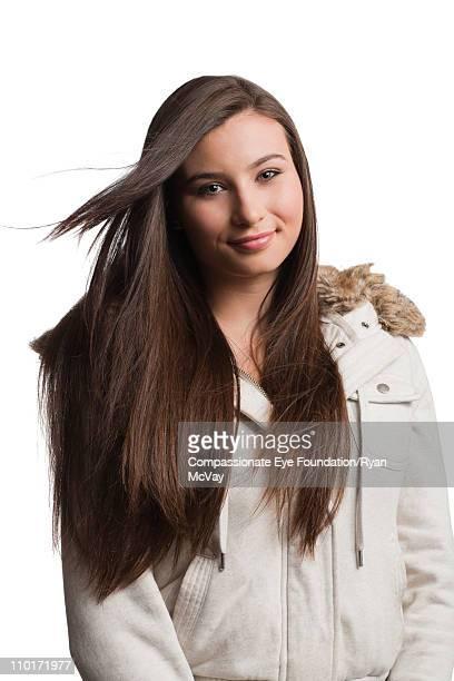 Portrait of brunette girl in warm jacket