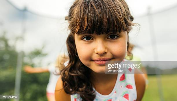 Portrait of brunette girl on trampoline