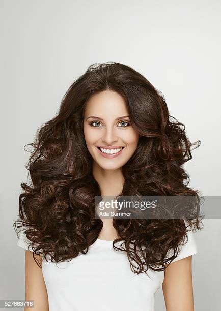 Portrait of brunette with curly long hair