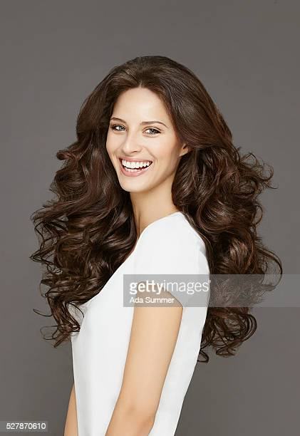 portrait of brunette with curly long hair - brown hair stock pictures, royalty-free photos & images