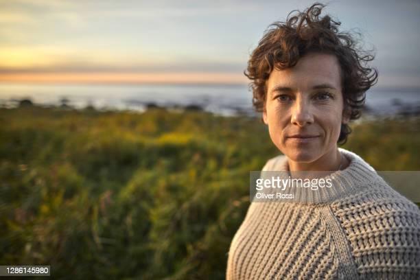 portrait of brunette woman at the coast. - retrato imagens e fotografias de stock