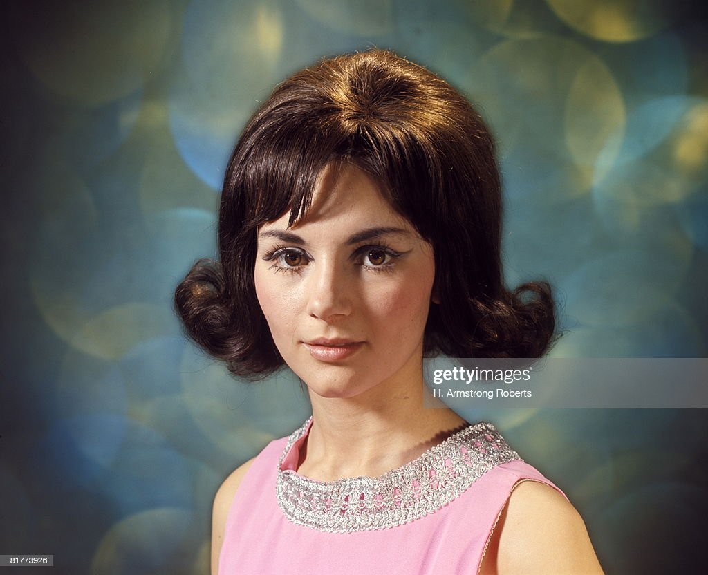 Portrait Of Brunette Woman With Flip Hairstyle Stock Photo