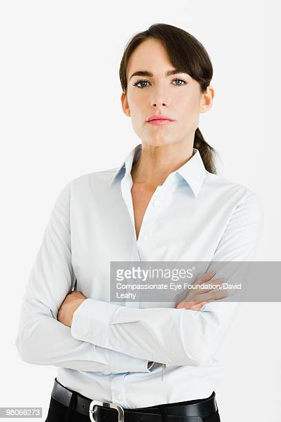 "portrait of brunette woman with her arms crossed - ""compassionate eye"" stock-fotos und bilder"