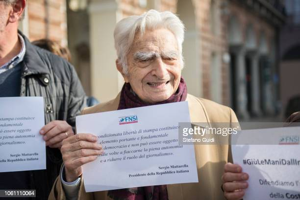 Portrait of Bruno Segre an Italian journalist holding a protest sign in writing with article 21 of the Italian constitution for the right to press...