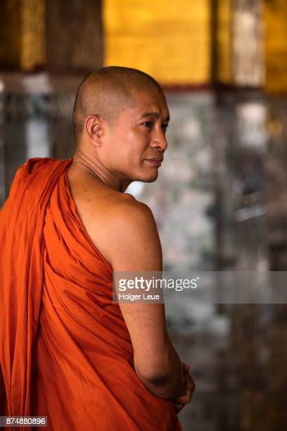 portrait of buddhist monk at mahamuni buddha temple, mandalay, mandalay, myanmar - television show stock pictures, royalty-free photos & images