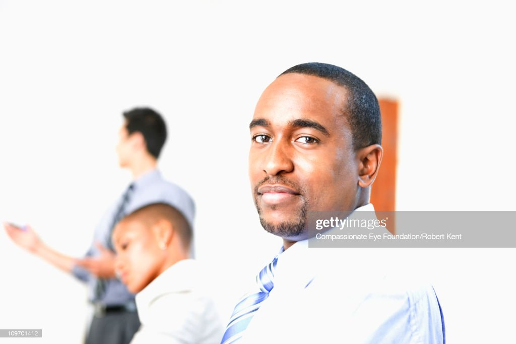 portrait of buisness man in foreground : Stock Photo