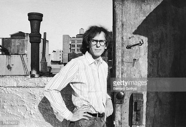 Portrait of Bulgarian artist Christo as he stands near a door on the roof of a building 1982