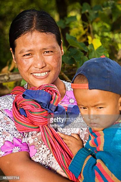 Portrait of burmese woman holding her baby
