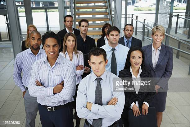 portrait of business colleagues standing together - organised group photo stock pictures, royalty-free photos & images