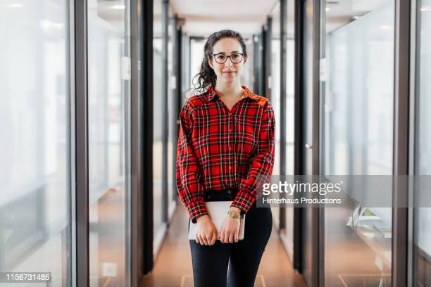 portrait of business employee holding digital tablet - cheerful stock pictures, royalty-free photos & images