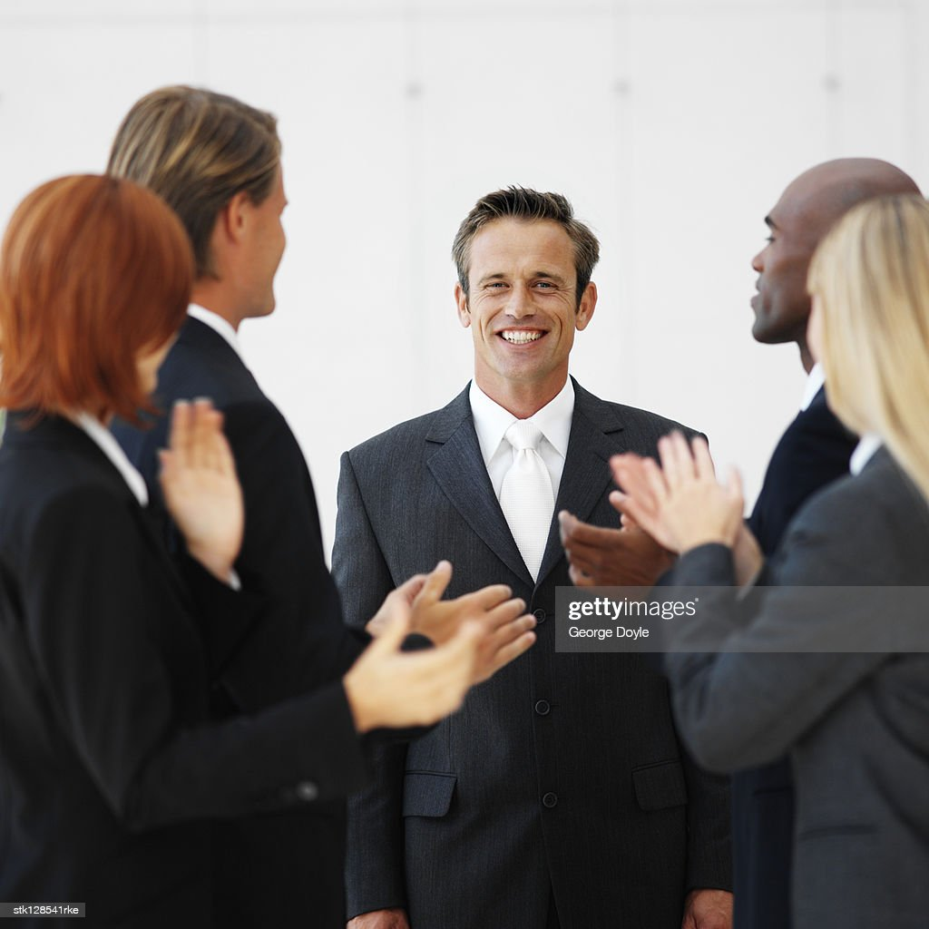 portrait of business executives applauding : Foto de stock
